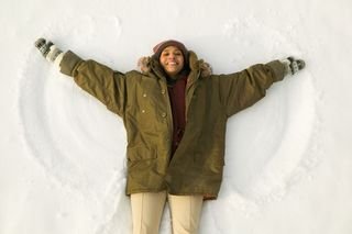 Happiness Woman Making Snow Angel