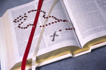 Catholic Rosary on Bible