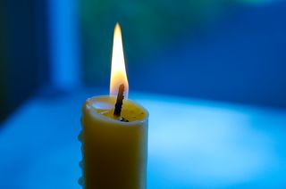 Candle Close Up With Blue Green Background