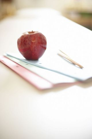 Teacher Apple on Desk With Pencils