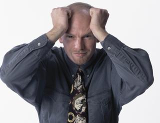 Man Tearing Hair Out