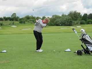 Golfer Driving Range