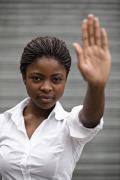 Assertiveness Woman Holding Hand Up